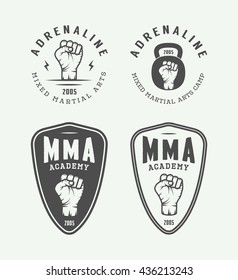 Set of vintage mixed martial arts or fighting club logos, emblems, badges, labels, marks and design elements. Retro graphic art. Vector Illustration.