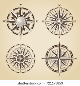 Set of vintage old antique nautical compass roses. Vector signs labels emblems.