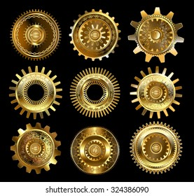 Set of vintage, patterned brass and gold gears on black background.