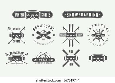 Set of vintage snowboarding or winter sports logos, badges, emblems and design elements. Vector illustration. Monochrome Graphic Art.