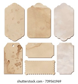 Set of vintage tags from old paper, different shapes cutout, with spilled coffee stain, brown and beige color, crumpled old aged paper, retro labels for special design.