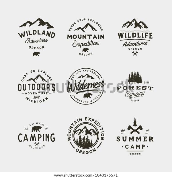 set of vintage wilderness logos. hand drawn retro styled outdoor adventure emblems, badges, design elements, logotype templates. vector illustration
