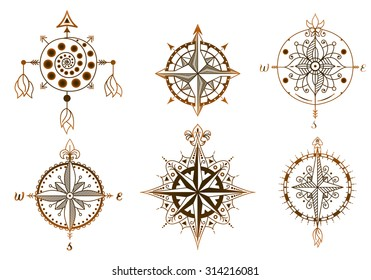 Set of vintage wind roses, compasses. Icons and design elements.