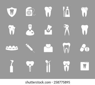 Set of white dental icons on grey background.