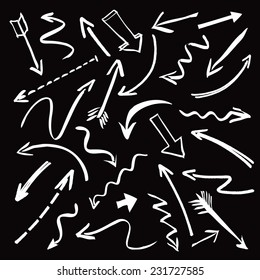 Set of white hand-drawn arrows on a black background. Vector outline illustration.