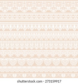 Set of white lace borders isolated on beige background