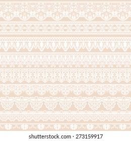 Set of white lace borders isolated on beige background