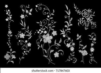 set of white lace. Traditional folk flower fashionable embroidery on the black background. A bouquet of roses and a dog rose, for printing on clothes, vector