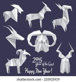 Set of white origami goats - symbols of 2015 New Year