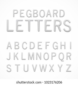 Set of white plastic pegboard letters. ABC letters isolated on white background. Plastic model-kit alphabet. Pegboard letters for your project.