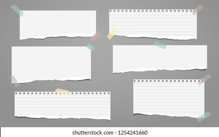 Set of white ripped lined notebook paper, torn note paper strips stuck on grey background. Vector illustration
