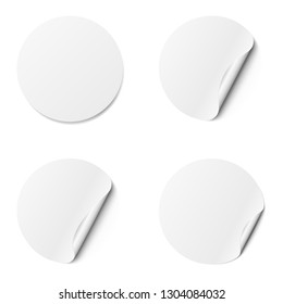 Set of white round adhesive stickers with a folded edges, isolated on white background.