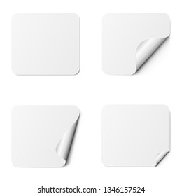 Set of white square adhesive stickers with a folded edges, isolated on white background.