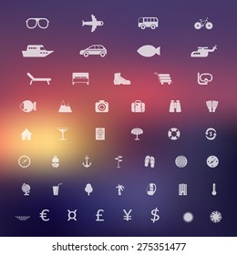 Set of white travel and tourism icons on blurred background