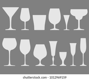 Set of white wineglass and glass icons placed on gray background. Vector illustration.