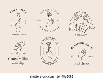 A set of women's hand logos in a minimalistic linear style. Vector design of sign templates or emblems in various gestures. For photographer, beauty Studio, Spa, tailor shop,embroidery, nail Studio