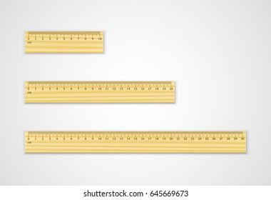 Set of wooden rulers 10, 20 and 30 centimeters with shadows isolated on white. Measuring tool. School supplies