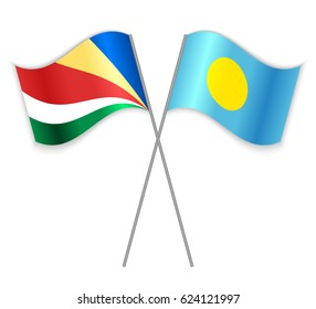 Seychellois and Palauan crossed flags. Seychelles combined with Palau isolated on white. Language learning, international business or travel concept.