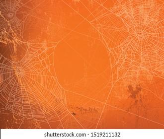 glänzende orangefarbene Wand mit unscharfem Spinnennetz - halloween heller Kopienhintergrund