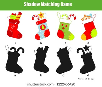 Shadow matching game for children. Find the right shadow for Christmas stockings. New year theme activity for kids