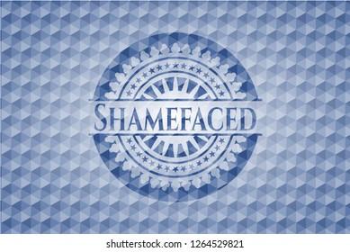 Shamefaced blue emblem with geometric pattern.