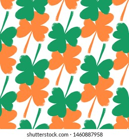 Shamrock leaf seamless pattern in Ireland flag colors. Trendy vector illustration for fashion fabric, paper, wrapping, packaging, wallpaper, poster, cover, interior decor, all over print.