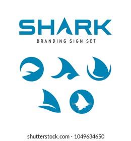 Shark branding signs set. Fish fin logotype templates. Shark logo symbols collection. Vector illustration.