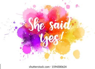 She said yes - handwritten lettering on watercolor splash. Multicolored. Inspirational illustration.