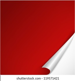 Sheet of red paper with curved corner.