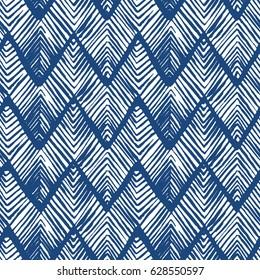 Shibori zig zag indigo triangles print. Geometrical japanese seamless pattern