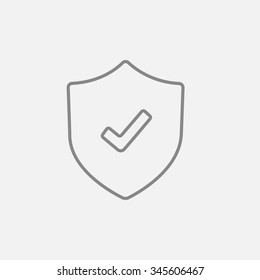 Shield with check mark line icon for web, mobile and infographics. Vector dark grey icon isolated on light grey background.