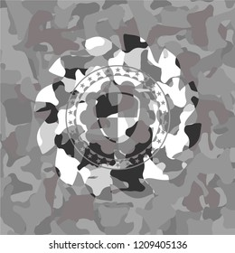 shield, safety icon on grey camouflaged texture