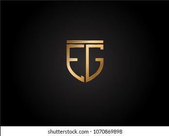EG shield shape Letter Design in gold color