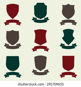 Shields and stylish ribbon set. Different shield shapes collection. Heraldic royal design. Colorful vector illustration.