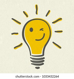Shining yellow light bulb isolated on white paper background. Emoji lightbulb with funny emotion. Hand-drawn vector illustration. Creative concept of idea.