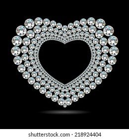 Shiny diamond heart on black background