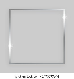 Shiny frame with glowing effects. Silver square frame with shadow on grey background. Vector illustration