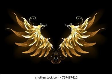 Shiny, golden angel wings on dark background.