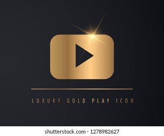 shiny, luxury and gold chrome play button on dark background.