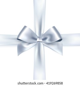 Shiny white satin ribbon on white background. Vector silver bow and ribbon.