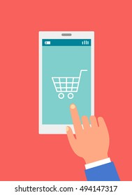 shopping online illustration, right hand touching a smart phone or tab with a white cart icon on its screen, all in soft red rectangle.
