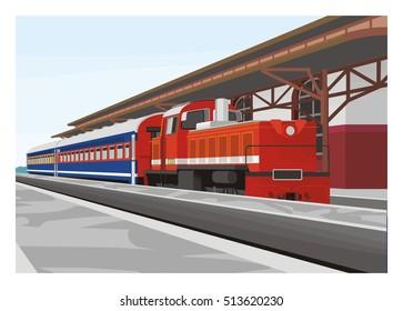 short passenger train arrives in a railway station
