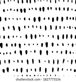 Short vertical lines hand drawn seamless pattern. Black and white simple vector confetti pattern with abstract dashes and lines. Horizontal dotted stripes. Grunge dash stain background for textile