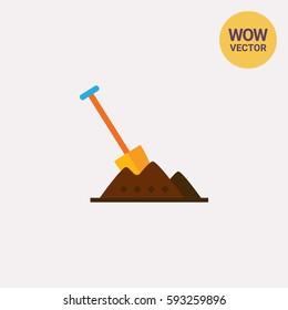 Shovel in heap of soil