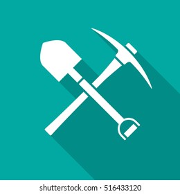 Shovel and pickaxe icon with long shadow. Flat design style. Shovel and pick axe silhouette. Simple green icon. Modern flat icon in stylish colors. Web site page and mobile app design vector element.