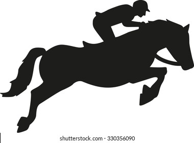 Show jumping horse with rider