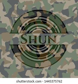 Shun written on a camouflage texture. Vector Illustration. Detailed.