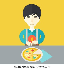 A sick asian man with heartburn due to pizza holding hands on his stomach vector flat design illustration. Square layout.