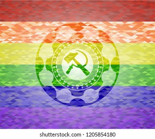 sickle and hammer icon inside emblem on mosaic background with the colors of the LGBT flag