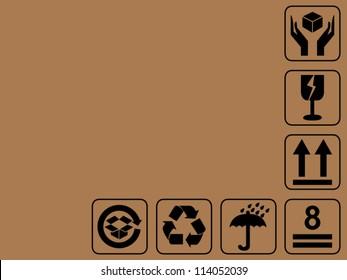 Side of cardboard box with black fragile symbol